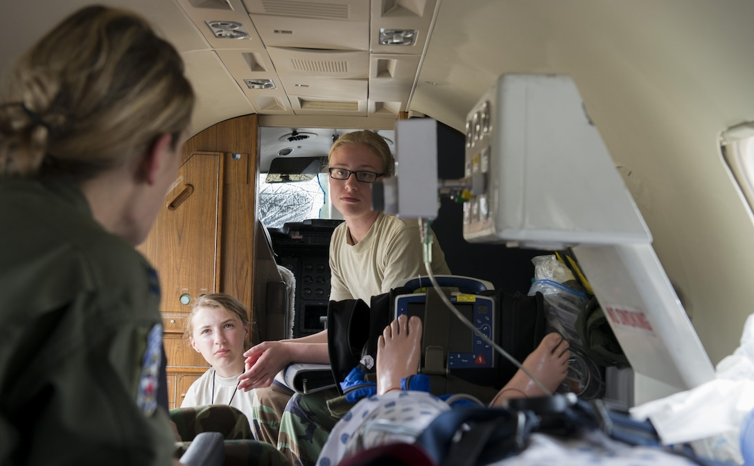 Capt. Erin Wood, 86th Aeromedical Evacuation Squadron flight nurse, shows Civil Air Patrol cadets inside a Gates Learjet C-21A aircraft during a tour June 22, 2016, at Ramstein Air Base, Germany. The aircraft was set up to demonstrate how a patient would be cared for on this aircraft during an aeromedical evacuation. CAP toured Ramstein from June 18 to 24, and visited squadrons associated with all three wings on base to get a glimpse of what life is like as an Airman. (U.S. Air Force photo/Airman 1st Class Tryphena Mayhugh)