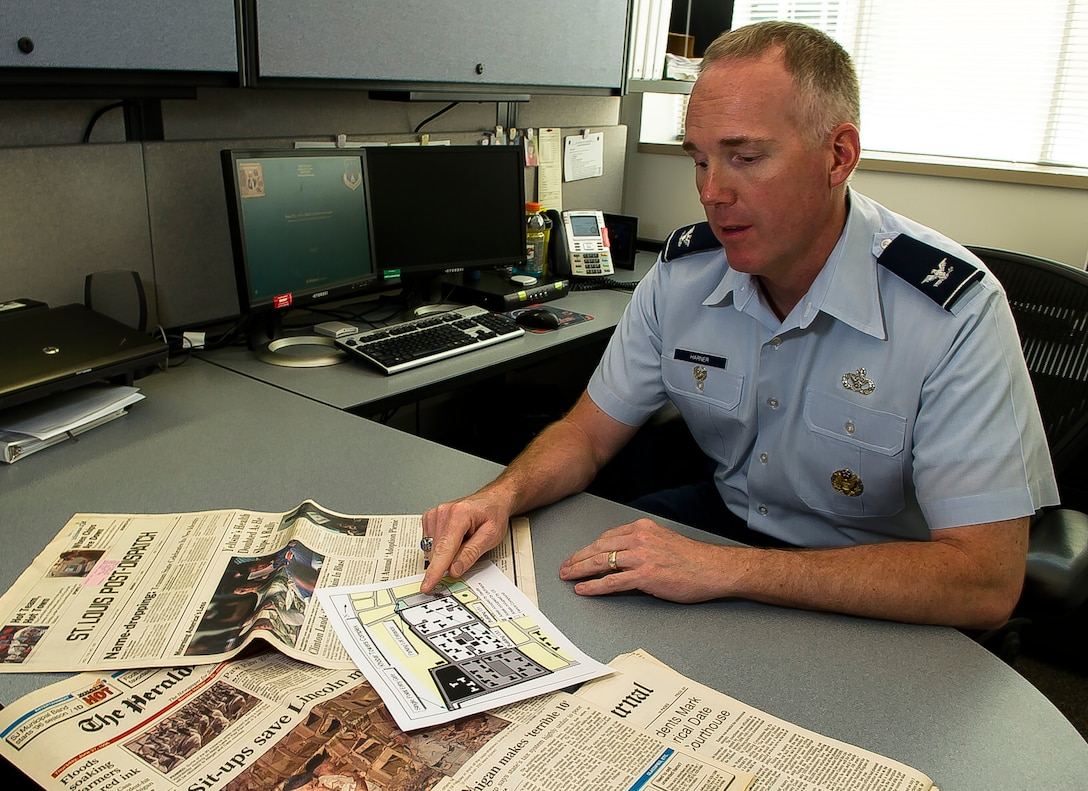 Col. Michael Harner, the associate director of civil engineers at the Pentagon in Washington, D.C., points to a spot on a map June 9, 2016, where the terrorist attack occurred on the Khobar Towers complex in Dharan, Saudi Arabia, on June 25, 1996. Harner was inside a building next to Bldg. 131, which was destroyed by a truck bomb. The attack killed 19 Airmen and injured more than 350 people, including Harner. (U.S. Air Force photo/Staff Sgt. Christopher Gross)