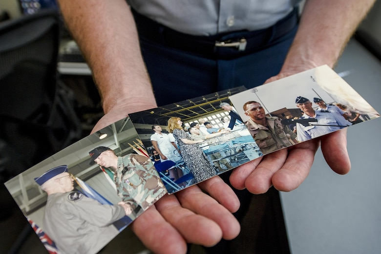 Col. Michael Harner, the associate director of civil engineers at the Pentagon in Washington, D.C., shows photos of himself June 9, 2016, following the terrorist attack on the Khobar Towers complex in Dharan, Saudi Arabia, on June 25, 1996. The photos included him receiving his Purple Heart and meeting former President Bill Clinton just days after the attack at Eglin Air Force Base, Fla. The attack killed 19 Airmen and injured more than 350 people. (U.S. Air Force photo/Staff Sgt. Christopher Gross)