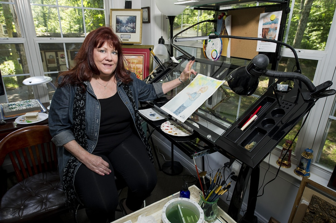 Selena Zuhoski sits inside her art studio at her home in Maryland on June 10, 2016. Zuhoski was in a recreational building when terrorists exploded a truck in front of Bldg. 131 of the Khobar Towers complex in Dharan, Saudi Arabia, on June 25, 1996. Zuhoski and a group of people were among the first to help victims following the explosion, which killed 19 Airmen and injured more than 350 people. Art has been therapeutic for Zuhoski in dealing with her post-traumatic stress disorder from the attack. (U.S. Air Force photo/Staff Sgt. Christopher Gross)