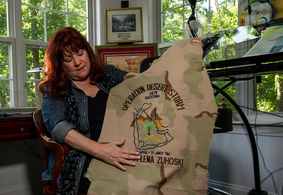 Selena Zuhoski shows a gift that she received following a deployment to Saudi Arabia in 1996 at her home in Maryland on June 10, 2016. Zuhoski was in a recreational building when terrorists exploded a truck in front of Bldg. 131 of the Khobar Towers complex in Dharan, Saudi Arabia, on June 25, 1996. Zuhoski and a group of people were among the first to help victims following the explosion, which killed 19 Airmen and injured more than 350 people. (U.S. Air Force photo/Staff Sgt. Christopher Gross)