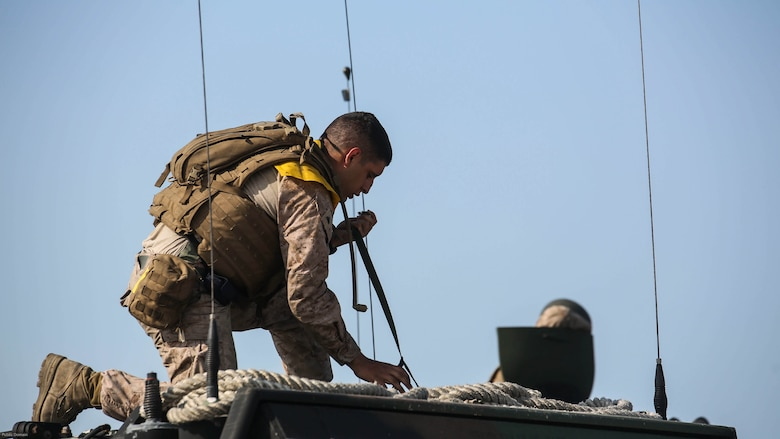 A Marine with Charlie Company, 4th Assault Amphibian Battalion secures equipment before conducting amphibious operations at Marine Corps Camp Lejeune, N.C., June 22, 2016. The company, based in Galveston, Texas, arrived in Camp Lejeune for a two-week annual training package.