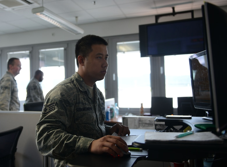Staff Sgt. Srun Sookmeewiriya, 313th Expeditionary Operations Support Squadron command post controller, works inside the air mobility control center at Ramstein Air Base, Germany, June 21, 2016. The 313th EOSS is responsible for the command and control of all 18th Air Force mobility aircraft that transports through Ramstein. (U.S.  Air Force photo/ Airman 1st Class Joshua Magbanua)