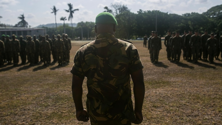 U.S. Marines and Sailors, with Task Force Koa Moana, join ranks with Papua New Guinea soldiers during the opening ceremony for Exercise Koa Moana, June 18, 2016, at Taurama Barracks, Papua New Guinea. The multi-national, bilateral exercise is designed to improve interoperability and relations by sharing infantry, engineering, medical and law enforcement skills.
