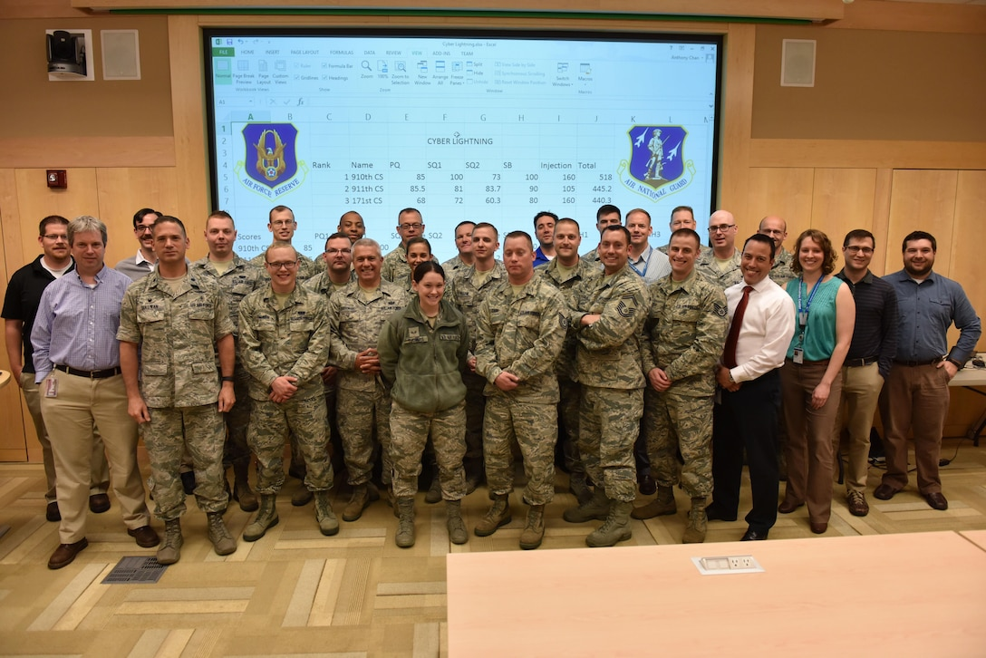 Communications Airmen from the 911th Airlift Wing, the 910th AW and the 171st Air Refueling Wing pose for a group photo during exercise Cyber Lightning at Carnegie Melon University, Pennsylvania, May 18, 2016. Cyber Lightning was a three-day exercise designed to teach Airmen about cyber threats and provide the skills needed to combat them. (U.S. Air Force photo by Airman Beth Kobily)