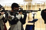 Army Spc. Dan Lowe, U.S. Army Marksmanship Unit, aims downrange during the 2016 Air Olympic trials at Camp Perry, Ohio, May 22, 2016. Lowe won an air rifle seat on the U.S. Olympic Shooting Team during June 5 Olympic trials, and will join three other USAMU soldiers at the 2016 Summer Olympic Games in Rio de Janeiro in August. Army photo by Brenda Rolin