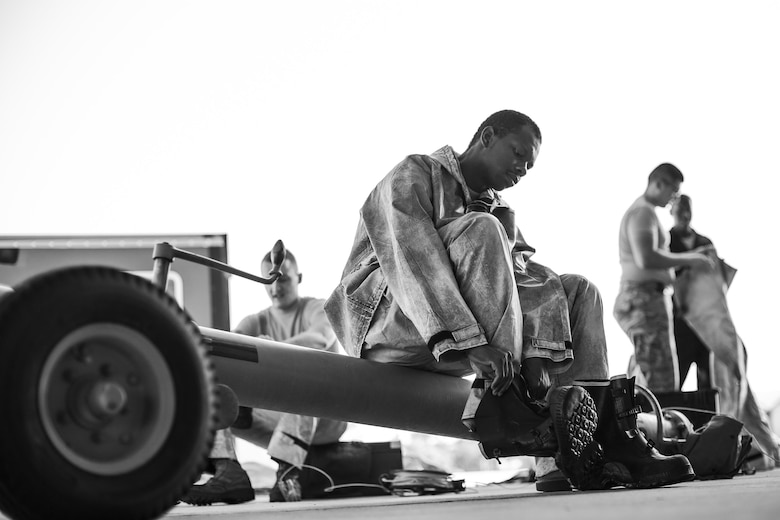 U.S. Air Force Senior Airman Zachary Moore, 23d Aircraft Maintenance Squadron Avionics Technician, dons personal protective equipment during an A-10C Thunderbolt II wash, June 16, 2016, at Moody Air Force Base, Ga. Hazardous material suits are required due to the chemicals used to clean the aircraft.(U.S. Air Force photo by Airman Daniel Snider/Released)