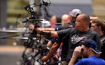 Master Sgt. Israel Del Toro Jr. uses his bite trigger to draw an arrow during the archery competition at the 2016 Department of Defense Warrior Games at the U.S. Military Academy in West Point, N.Y., June 17, 2016. The Warrior Games took place from June 15-21, and is an adaptive sports competition for wounded, ill and injured service members and veterans. Athletes represented teams from the Army, Marine Corps, Navy, Air Force, U.S. Special Operations Command and the U.K. armed forces. They competed in archery, cycling, track and field, shooting, sitting volleyball, swimming, and wheelchair basketball. (U.S. Air Force photo/Staff Sgt. Carlin Leslie)