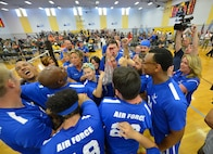 Secretary of the Air Force Deborah Lee James celebrates with the Air Force wounded warrior sitting volleyball team after their gold medal victory at the 2016 Department of Defense Warrior Games at the U.S. Military Academy in West Point, N.Y., June 21, 2016. The Warrior Games took place from June 15-21, and is an adaptive sports competition for wounded, ill and injured service members and veterans. (U.S. Air Force photo/Staff Sgt. Carlin Leslie)