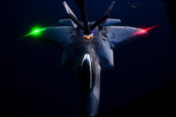 An F-22 Raptor is being refueled by a KC-135 Stratotanker over the Nevada Test and Training Range during the U.S. Air Force Weapons School's Deliberate Strike Night, June 16, 2016. DSN is part of the final seven-day advanced integration portion of the school's curriculum, testing stealth and conventional airframes' abilities to conduct attacks during the hours after the sun sets. The F-22 is assigned to the 433rd Weapons Squadron and the KC-135 is assigned to the 509th Weapons Squadron. (U.S. Air Force photo/Airman 1st Class Kevin Tanenbaum)