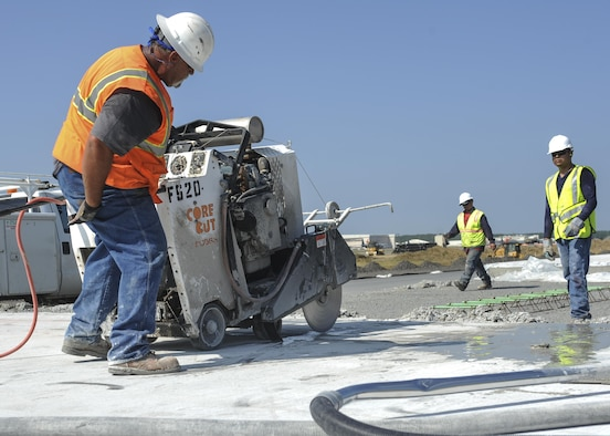 Mark Roncal, an Advanced Cutting Concrete and Sealing contractor, cuts concrete on the runway construction site June 21, 2016, at Little Rock Air Force Base, Ark. A section of Little Rock AFB runway is receiving an update from its original 1955 build. (U.S. Air Force photo by Senior Airman Mercedes Taylor)