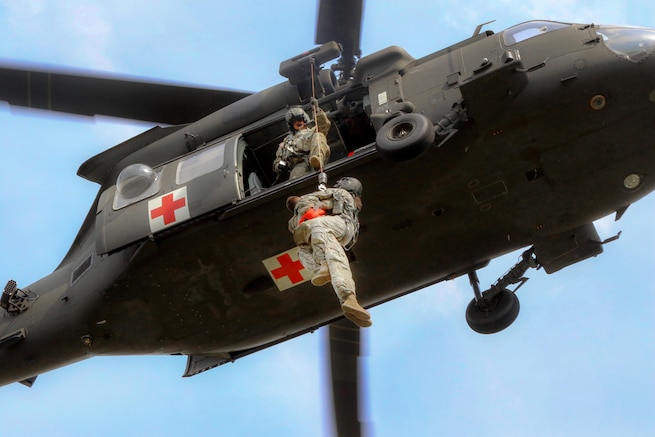 Army flight medics ascend on a hoist line with a simulated patient during medical evacuation training part of a joint exercise at Fort Bragg, N.C., June 23, 2016. The soldiers are assigned to the 82nd Airborne Division's 3rd Brigade Combat Team, 82nd Combat Aviation Brigade. Army photo by Sgt. Anthony Hewitt