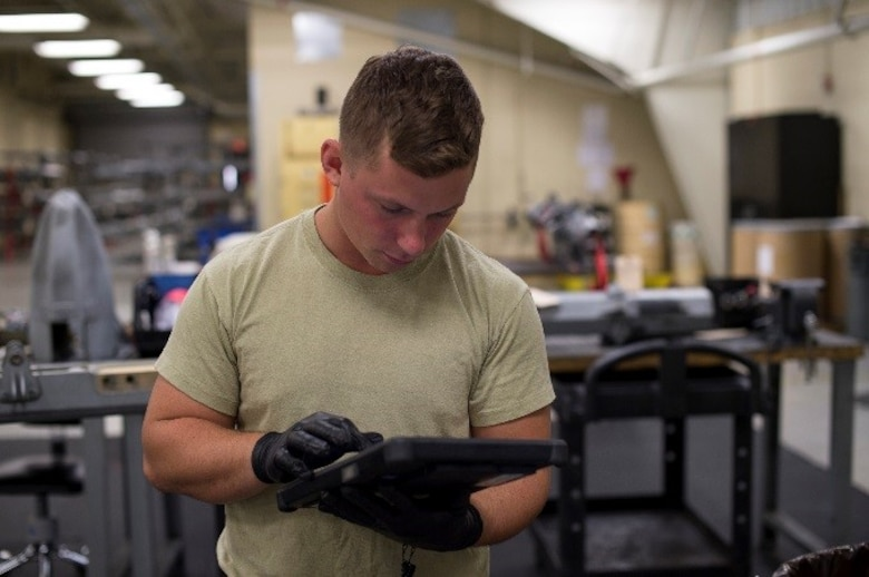 U.S. Air Force Senior Airman Shelby Demorest, 23d Equipment Maintenance Squadron armament technician, checks his technical data to ensure accuracy, June 22, 2016, at Moody Air Force Base, Ga. Demorest plans to finish his Career Development Courses so he can start on his Community College of the Air Force degree and use those credits towards a Bachelor's Degree in Aeronautics at Embry-Riddle Aeronautical University. (U.S. Air Force photo by Airman 1st Class Janiqua P. Robinson/Released)