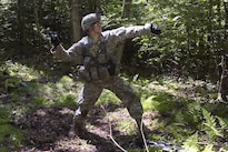 Army Spc. John Nicastro prepares to throw a smoke grenade during annual training at Camp Ethan Allen Training Site, Jericho, Vt., June 15, 2016. Nicastro is assigned to the Vermont National Guard's Company A, 3rd Battalion, 172nd Infantry Regiment, 86th Infantry Brigade Combat Team. The unite is participating in an assault lane as part of a buddy-team exercise during his two-week annual training. Air National Guard photo by Tech. Sgt. Sarah Mattison