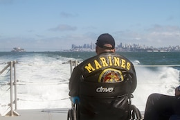 A military veteran takes in the views of the San Francisco Bay Area May 25 while onboard the M/V John A. B., Dillard, Jr., a U.S. Army Corps of Engineers San Francisco District vessel. The outing was organized by the Department of California Disabled American Veterans.