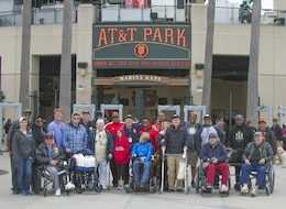 A group of disabled veterans, family members, friends and caregivers pose for a group photo outside AT&T Park, home of the San Francisco Giants May 25. The outing was organized by the Department of California Disabled American Veterans and the U.S. Army Corps of Engineers San Francisco District.