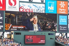 Mickey Ganitch, a Pearl Harbor survivor, is shown on the San Francisco Giants scoreboard May 25. The outing was organized by the Department of California Disabled American Veterans and the U.S. Army Corps of Engineers San Francisco District.