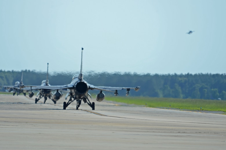 U.S. Air Force pilots assigned to the 20th Fighter Wing taxi on the runway during a surge at Shaw Air Force Base, S.C., June 21, 2016. The surge aided the 20th FW in gaining flying hours lost due to inclement weather and other unsafe flying conditions. (U.S. Air Force photo by Airman 1st Class Christopher Maldonado)