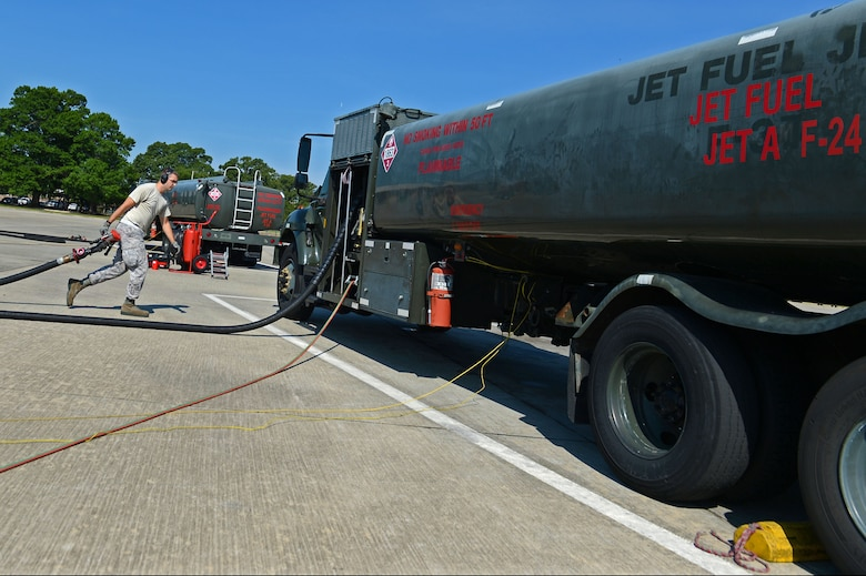 U.S. Air Force Staff Sgt. Tray Martin, 20th Logistics Readiness Squadron fuels distribution supervisor, returns a hose to a fuel truck during a surge at Shaw Air Force Base, S.C., June 21, 2016. Petroleum, oil, and lubricant operators are capable of refueling approximately 30 aircraft in about three hours. (U.S. Air Force photo by Airman 1st Class Christopher Maldonado)