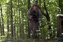 U.S. Army Spc. John Nicastro advances through the woods to his next objective during annual training at Camp Ethan Allen Training Site, Jericho, Vt., June 15, 2016. Nicastro is assigned to the Vermont National Guard's Company A, 3rd Battalion, 172nd Infantry Regiment, 86th Infantry Brigade Combat Team. Air National Guard photo by Tech. Sgt. Sarah Mattison