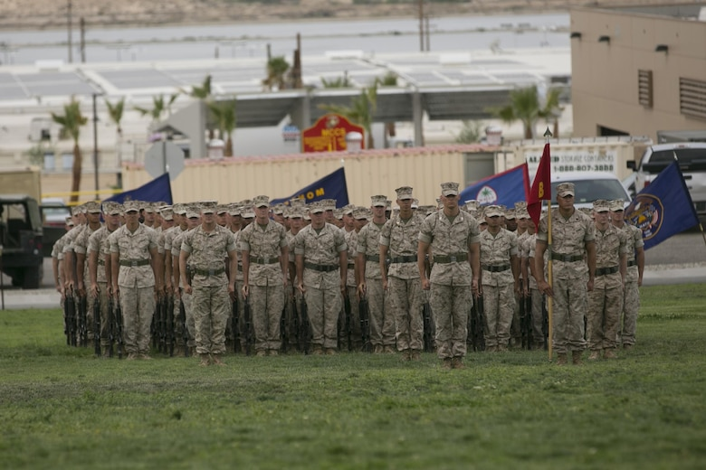 Marines of 1st Battalion, 7the Marine Regiment stand at the position of attention during the battalion's change of command ceremony at Lance Cpl. Torrey L. Gary Field, June 21, 2016. (Official Marine Corps photo by Cpl. Thomas Mudd/Released)