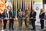 Defense Logistics Agency Energy Deputy Commander George Atwood [second to left] and other stakeholders participate in a ribbon-cutting ceremony with other senior officials for the large-scale renewable energy solar project at Fort Detrick, Maryland, June 17.