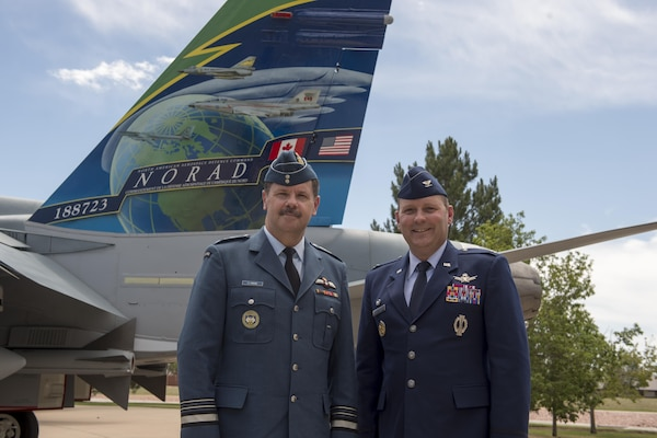 Lt.-Gen Pierre St-Amand, NORAD Deputy Commander, and Col Douglas Schiess, 21st Space Wing Commander, with the tail art of the new display of a CF-188A Hornet (tail number 188723) fighter jet at the Peterson Air and Space Museum at Peterson Air Force Base, Colo. June 24, 2016. The jet was donated by the Government of Canada to the USAF Heritage Program as a gesture of appreciation for the U.S. and Canada's longstanding and continued partnership through the North American Aerospace Defense Command. The CF-188 has been used by Canada since 1984 to conduct NORAD's missions. (Photo by TSgt Joe Laws, Released)