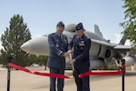 Lt.-Gen Pierre St-Amand, NORAD Deputy Commander, and Col Douglas Schiess, 21st Space Wing Commander, cut the ribbon on the new display of a CF-188A Hornet (tail number 188723) fighter jet at the Peterson Air and Space Museum at Peterson Air Force Base, Colo. June 24, 2016. The jet was donated by the Government of Canada to the USAF Heritage Program as a gesture of appreciation for the U.S. and Canada's longstanding and continued partnership through the North American Aerospace Defense Command. The CF-188 has been used by Canada since 1984 to conduct NORAD's missions. (Photo by TSgt Joe Laws, Released)