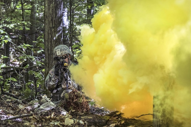 Army Pfc. Saul Hernandez provides security before advancing under smoke cover during training at Camp Ethan Allen Training Site in Jericho, Vt., June 15, 2016. Watkins is assigned to the Vermont National Guard's Company A, 3rd Battalion, 172nd Infantry Regiment. Air National Guard photo by Tech. Sgt. Sarah Mattison