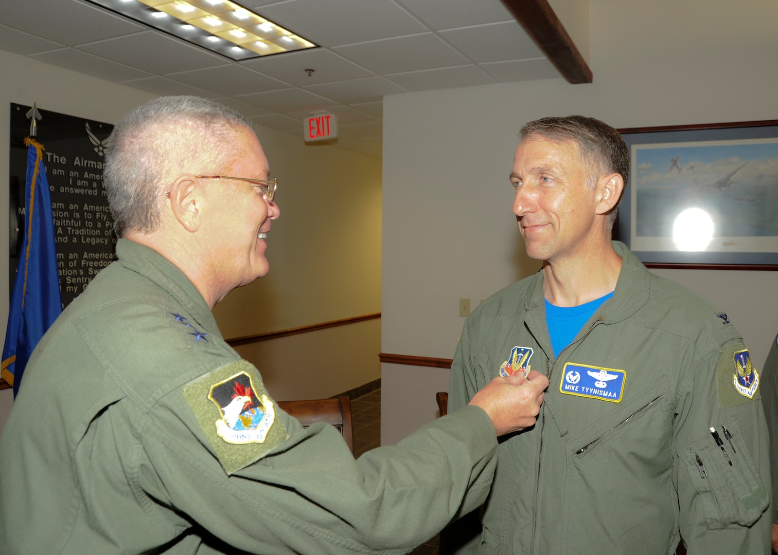 """As part of the Transfer of Authority ceremony held today to recognize the realignment of the Civil Air Patrol-U.S. Air Force – or CAP-USAF – from Air Education and Training Command to Air Combat Command, Lt. Gen. William Etter, commander of Continental U.S. NORAD Region-1st Air Force (Air Forces Northern) did a symbolic """"patch swap"""" replacing the Air Education and Training Command and Air University patches for the new ACC and 1 AF patches on the uniform of  CAP-USAF commander, Col. Mike Tynismaa."""