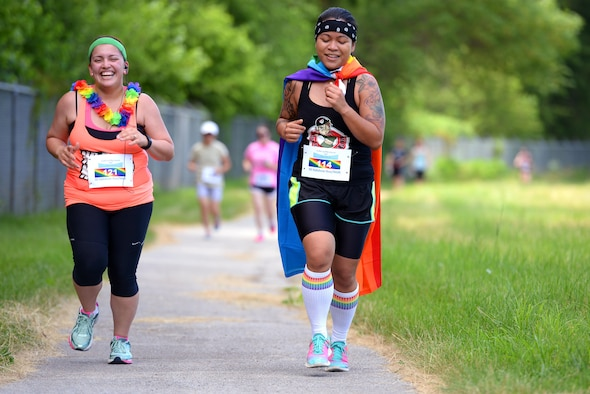 Staff Sgt. Diane Balmer, left, 55th Force Support Squadron, and Hazael Policarpio, 49th Intelligence Squadron, participate in the Rainbow 5K Run/Walk June 23 at Offutt Air Force Base, Neb. The event was held as part of LGBT pride month to celebrate diversity among DOD members. (U.S. Air Force photo by Delanie Stafford/Released)
