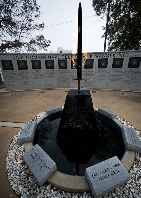 The fiery sword at the center of the Nomad Memorial burns bright through the foggy morning Feb. 18, 2011, at Eglin Air Force Base, Fla. The memorial was constructed to honor the hundreds of wounded personnel and 19 Airmen who lost their lives during the Khobar Towers bombing on June 25, 1996. (U.S. Air Force photo/Samuel King Jr.)