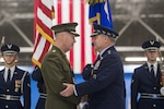 Marine Corps Gen. Joe Dunford, chairman of the Joint Chiefs of Staff, congratulates Air Force Chief of Staff Gen. Mark A. Welsh III during Welsh's retirement ceremony at Joint Base Andrews, Md., June 24, 2016. Commissioned as an Air Force officer in June 1976, Welsh became Air Force chief of staff in August 2012. DoD photo by Navy Petty Officer 2nd Class Dominique A. Pineiro
