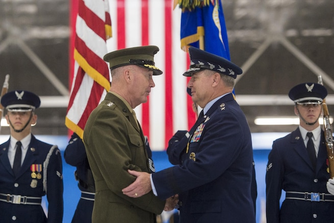 Marine Corps Gen. Joe Dunford, chairman of the Joint Chiefs of Staff, congratulates Air Force Chief of Staff Gen. Mark A. Welsh III during Welsh's retirement ceremony at Joint Base Andrews, Md., June 24, 20156. Welsh became chief of staff in August 2012. DoD photo by Navy Petty Officer 2nd Class Dominique A. Pineiro