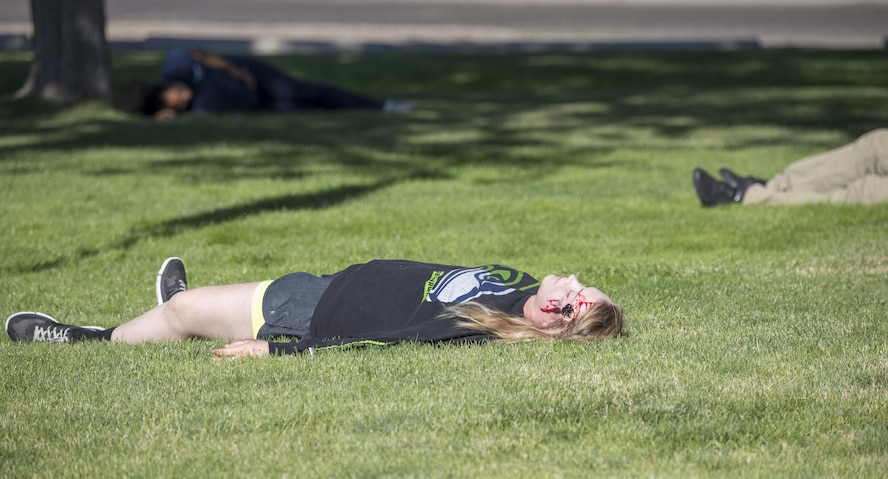 A military member poses as a downed victim during an active shooter exercise June 23, 2016, in downtown Mountain Home, Idaho. Mountain Home Air Force Base participated in an active shooter exercise lead by Mountain Home law enforcement. (U.S. Air Force photo by Senior Airman Jeremy L. Mosier/Released)