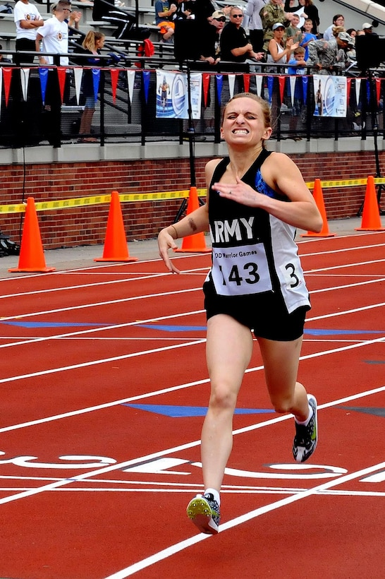 U.S. Army Reserve Staff Sgt. Megan Grudzinski, from Strongsville, Ohio, crosses the finish line for a first-place finish well ahead of the second place runner during the 800-meter event at the Track portion of the 2016 Department of Defense Warrior Games held at the U.S. Military Academy at West Point, New York, June 16. The DoD Warrior Games, June 15-21, is an adaptive sports competition for wounded, ill and injured service members and Veterans. (U.S. Army photo by Master Sgt. D. Keith Johnson/Released)
