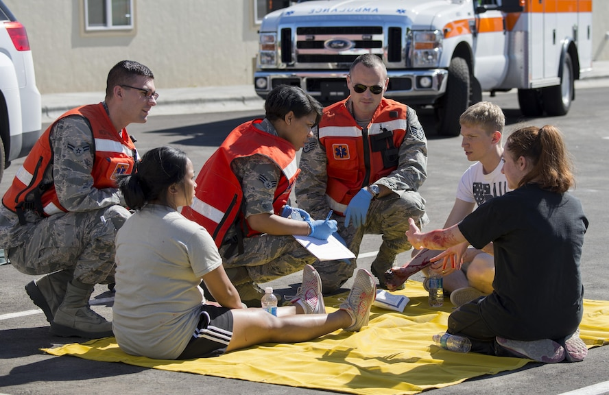 Military members assist simulated victims during an active shooter exercise June 23, 2016, in downtown Mountain Home, Idaho. The 366th Medical Group sent first responders to the scene within 20 minutes of receiving the call for assistance during the active shooter exercise.(U.S. Air Force photo by Senior Airman Jeremy L. Mosier/Released)