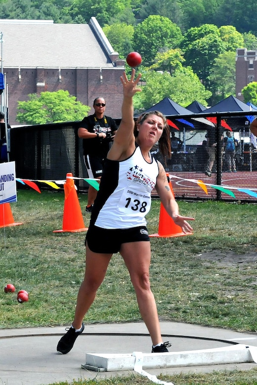 U.S. Army Reserve Staff Sgt. Ashley Anderson, from Winnebago, Minnesota, throws a shot put during the Field portion of the 2016 Department of Defense Warrior Games held at the U.S. Military Academy at West Point, New York, June 16. The DoD Warrior Games, June 15-21, is an adaptive sports competition for wounded, ill and injured service members and Veterans. (U.S. Army photo by Master Sgt. D. Keith Johnson/Released)