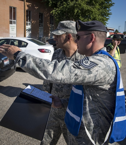 Military members assess the participation by the 366th Fighter Wing during the active shooter exercise June 23, 2016, in downtown Mountain Home, Idaho. These members were on scene to grade how the response was handled by Mountain Home Air Force Base personnel.(U.S. Air Force photo by Senior Airman Jeremy L. Mosier/Released)