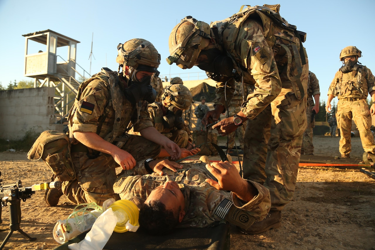 British soldiers strap a U.S. soldier to a litter during a medical evacuation simulation as part of the Swift Response 16 training exercise at Hohenfels Training Area in Hohenfels, Germany, Jun. 23, 2016. More than 5,000 service members from 10 countries are participating in the exercise. Following yesterday's historic decision by voters in the United Kingdom to withdraw from the European Union, Defense Secretary Ash Carter spoke by telephone June 24 with his U.K. counterpart, Defense Secretary Michael Fallon. Carter emphasized that the U.S. and the U.K. will always enjoy a special relationship that's reflected in the two nations' close defense ties, Pentagon Press Secretary Peter Cook said in a readout of the call. Army photo by Spc. Nathaniel Nichols