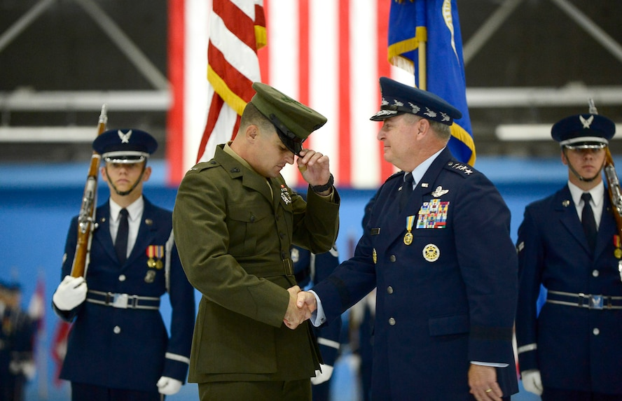 After 40 years of service, Air Force Chief of Staff Gen. Mark A. Welsh III is retired by his son, U.S. Marine Corps 1st Lt. Matthew Welsh, during a ceremony at Joint Base Andrews, Md., June 24, 2016.  Welsh has served as the 20th chief of staff since 2012. (U.S. Air Force photo/Tech. Sgt. Joshua L. DeMotts)