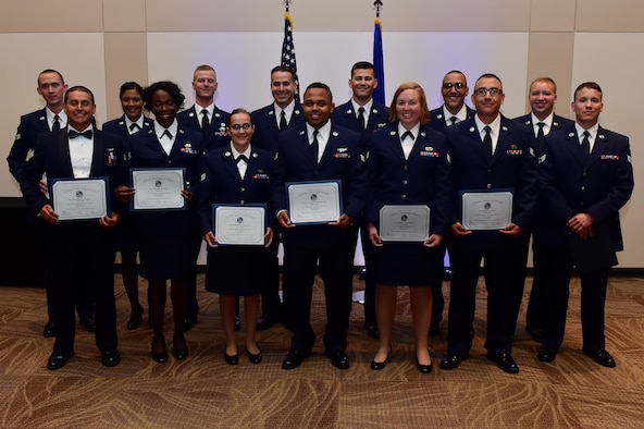 Buckley Airman Leadership School Class 16-E stand together after their graduation June 23, 2016, at the Leadership Development Center on Buckley Air Force Base, Colo. This graduation represents an important part of enlisted force professional military education, teaching valuable skills required for supervisors. (U.S. Air Force photo by Airman 1st Class Gabrielle Spradling/Released)