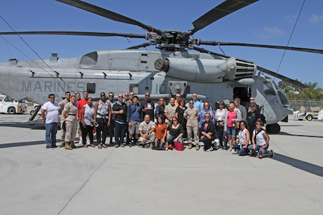 Recruiting Station Los Angeles Marines and more than 30 high school educators from Los Angeles pose for a photo during their tour on the flight line at Marine Corps Air Station Miramar, June 15, 2016, as part of RS Los Angeles' Educators Workshop. High school educators, consisting of teachers, coaches, and counselors from Los Angeles took part in joint educators workshop with Recruiting Stations San Diego and San Francisco. The workshop was a week-long, June 13-17, event in San Diego where educators got an opportunity to see recruit training firsthand, talk with Marine Corps drill instructors, and recruits in training, and was able to talk to active-duty Marines while aboard a Marine Corps installation. Thirty-one educators from the Los Angeles area made the annual trip. Each visit lasts one week, and participants also experience life on Marine Corps Base Camp Pendleton and Marine Corps Airs Station Miramar. (U.S. Marine Corps photo by Staff Sgt. Alicia R. Leaders/Released)