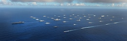 In this file photo, Forty-two ships and submarines representing 15 international partner nations steam in close formation during exercise Rim of the Pacific (RIMPAC) 2014.