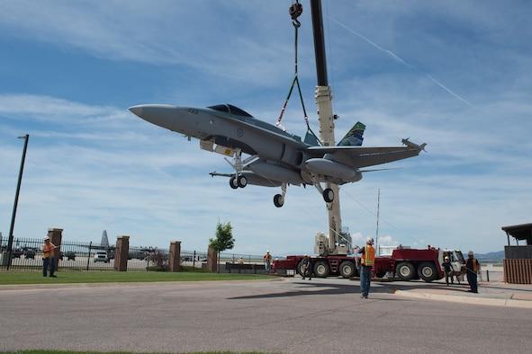 PETERSON AIR FORCE BASE, Colo. – A donated CF-188A Hornet is transported to the Peterson Air Force Base Museum Air Park prior to a dedication ceremony June 24, 2016. The aircraft (tail number 188723) was donated by the Government of Canada to the USAF Heritage Program as a gesture of appreciation for the U.S. and Canada's longstanding and continued partnership through the North American Aerospace Defense Command. (courtesy photo)