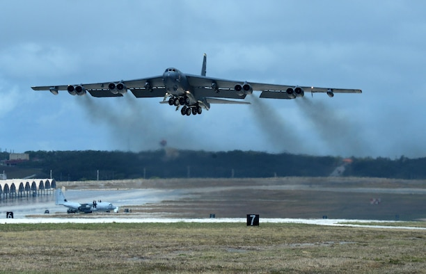 A U.S Air Force B-52 Stratofortress bomber from Minot Air Force Base, North Dakota, takes flight June 16, 2016, at Andersen Air Force Base, Guam. The aircraft is deployed in support of U.S. Pacific Command's Continuous Bomber Presence operations. This forward deployed presence demonstrates continuing U.S. commitment to stability and security in the Indo-Asia-Pacific region. (U.S. Air Force photo by Airman 1st Class Alexa Ann Henderson/Released)