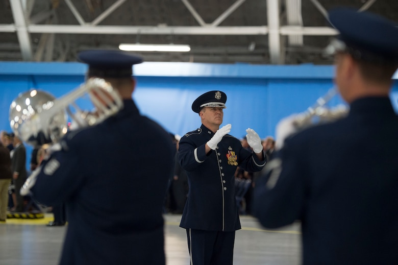 Col. Larry Lang, U.S Air Force Band commander/conductor, leads the band during a performance for the retirement ceremony of Air Force Chief of Staff Gen. Mark Welsh III at Joint Base Andrews, Md., June 24 2016. Welsh retired effective July 1, 2016 after 40 years of honorable military service with military leaders, personnel, friends and family attending the ceremony. (U.S. Air Force photo by Airman 1st Class Rustie Kramer)