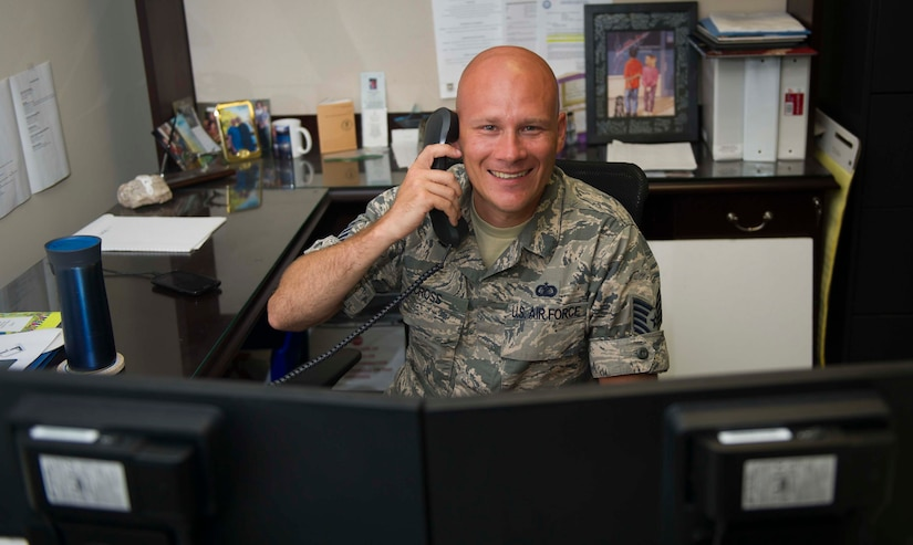 Tech. Sgt. Christopher Cross, 628th Air Base Wing executive support non-commissioned officer, on the phone June 14, 2016, at Joint Base Charleston, S.C. Cross plans to visit a vineyard in Landrum, S.C. for the 4th of July. Cross said Independence Day is a good day to reflect on what American forefathers have done for the freedoms we enjoy. (U.S. Air Force photo/Airman 1st Class Kevin West)