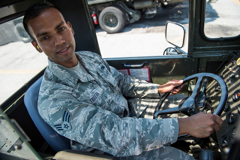 Senior Airman Nadira Tissera, a 437th Aerial Port Squadron ramp services journeyman, prepares to operate a 60K loader on the flightline, June 22, 2916 at Joint Base Charleston, S.C. Tissera has plans to visit his family in Pennsylvania for a family barbeque during the 4th of July. He was born in Sri Lanka and says he is grateful to be a part of a free country and to be serving in the military. (U.S. Air Force photo/Staff Sgt. Jared Trimarchi)