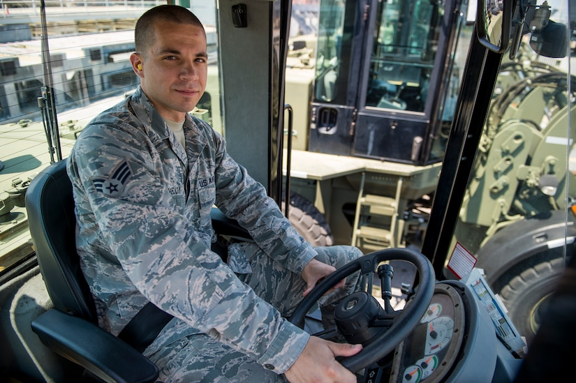 Senior Airman Brett Lovejoy, a 437th Aerial Port Squadron ramp services journeyman, sits in a forklift before heading to the flightline June 22, 2016 at Joint Base Charleston, S.C. Lovejoy is scheduled to work during the 4th of July holiday and as is happy to do so. He said the aerial port here runs 24 hours a day 365 days a year and he is proud to be an Airman in the world's greatest air force. (U.S. Air Force photo/Staff Sgt. Jared Trimarchi)